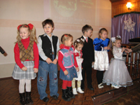 Kids recite Christmas poems at church Christmas celebration.