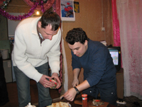 Paul and Misha preparing snacks in Beliarsk.